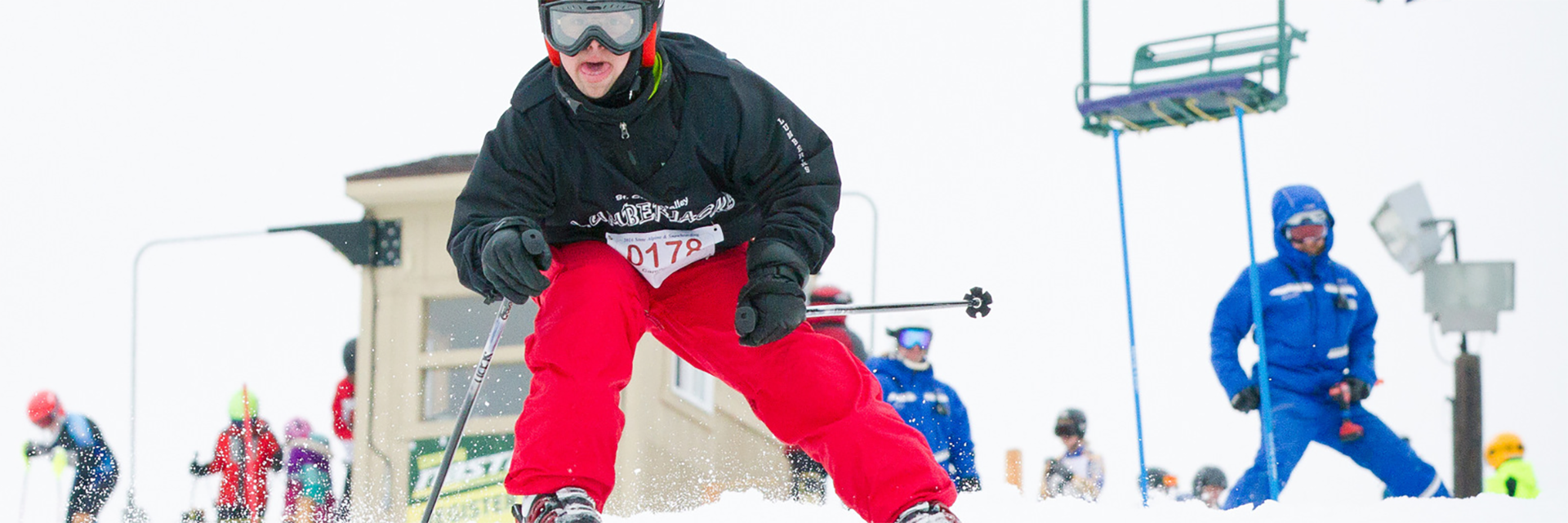 Special Olympics Minnesota alpine skier skiing down hill