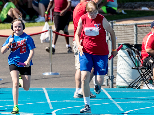 Special Olympics Minnesota track athlete running race
