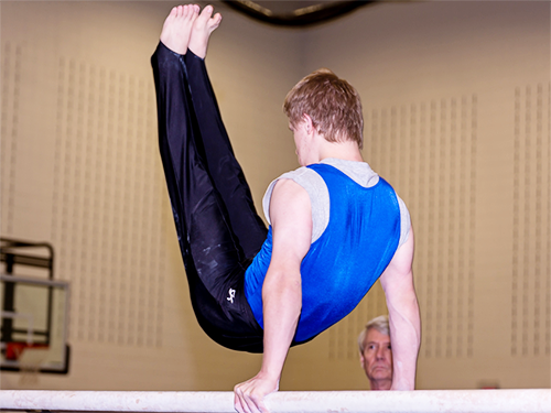 Special Olympics Minnesota gymnast doing exercise