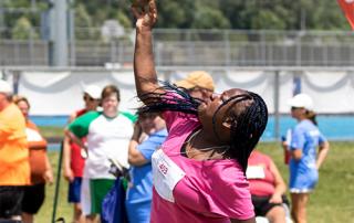 Special Olympics Minnesota shot put athlete throwing shot put
