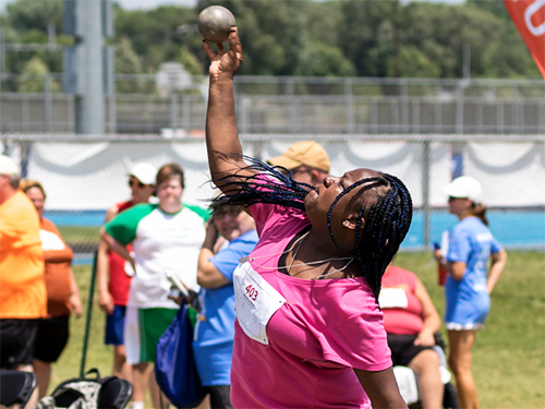 Special Olympics Minnesota shot put athlete throwing shot put