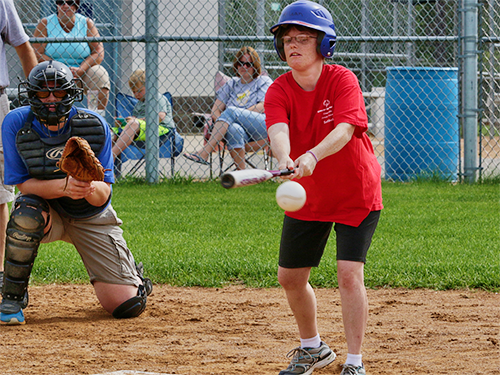 Special Olympics Minnesota softball athlete batting