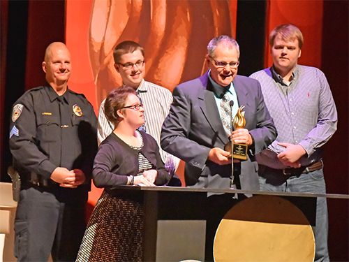 Group of Distinguished Service Awards speakers with award winner