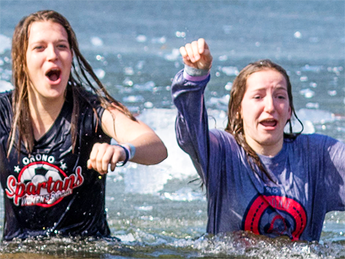 Two Eden Prairie Polar Plunge participants in lake