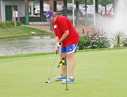 Special Olympics Minnesota golfer putting