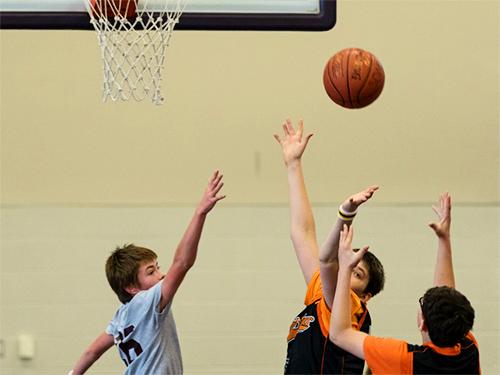 Special Olympics Minnesota basketball athletes playing basketball game