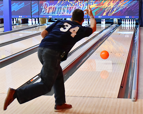 Special Olympics Minnesota bowler bowling ball down lane