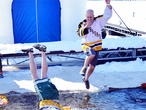 Two Warroad Polar Plunge participants jumping into lake