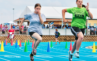 Two Special Olympics Minnesota track athletes running race