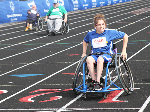 Special Olympics Minnesota wheelchair track athlete running race