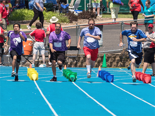 Group of Special Olympics Minnesota track athletes running race