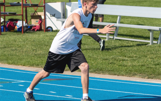 Special Olympics Minnesota track athlete running race
