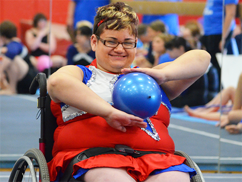 Special Olympics Minnesota wheelchair gymnast doing ball exercise