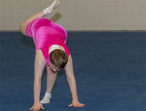 Special Olympics Minnesota gymnast doing floor exercise