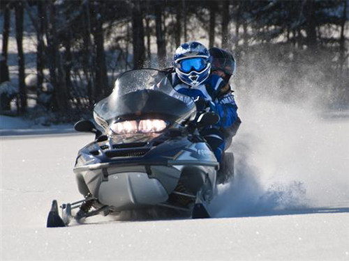 Two Northland 300 participants riding snowmobile