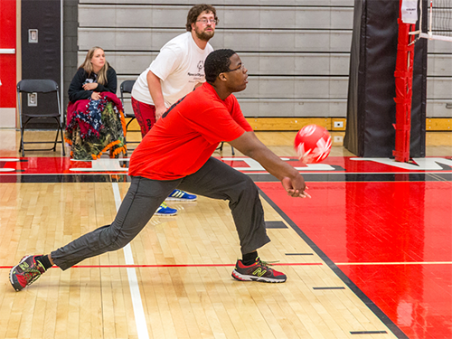 Special Olympics Minnesota athlete playing volleyball
