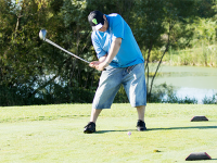 Special Olympics Minnesota athlete swinging a golf club