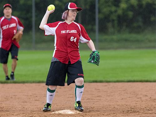 Female Special Olympics Minnesota athlete prepares to throw a softball