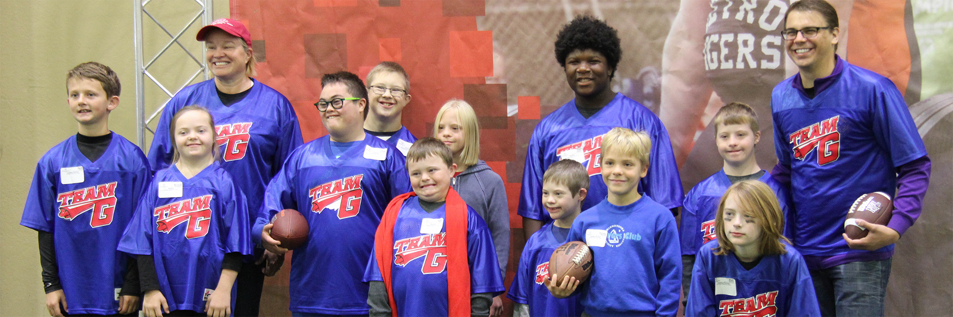 A group of Special Olympics Minnesota athletes aged 8-12 with two adult coaches