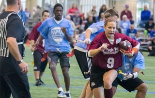 A group of Special Olympics Minnesota athletes play football
