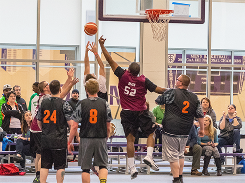 A Special Olympics Minnesota team plays basketball