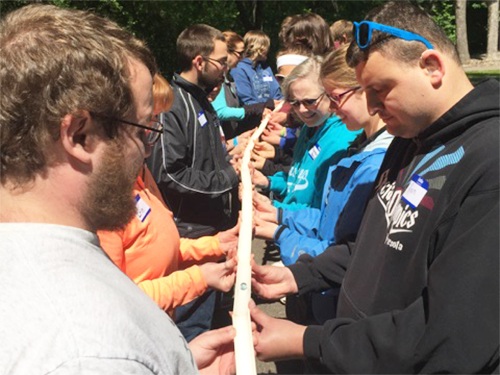 A group of Special olympics Minnesota athletes hold a marble track