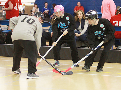 Three Special Olympics Minnesota athletes square off on the poly hockey court