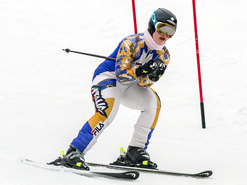 A Special Olympics Minnesota athlete skis downhill