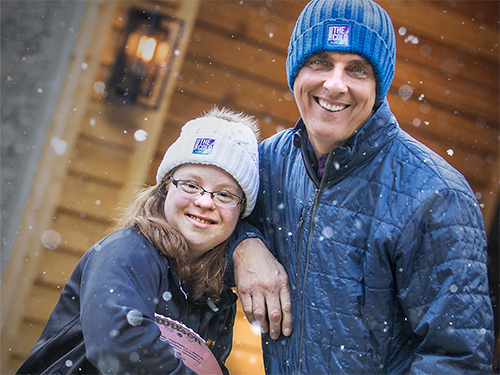 Special Olympics Minnesota athlete Abby models a winter hat with Storm Creek employee