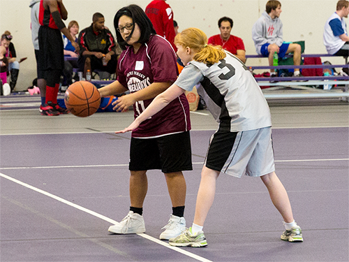 Two Special Olympics Minnesota athletes face off on the basketball court