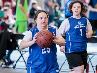 Two Special Olympics Minnesota athletes play basketball