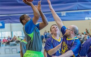 Special Olympics Minnesota athletes play basketball