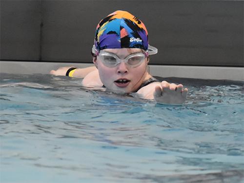A Special Olympics Minnesota athlete prepares to swim