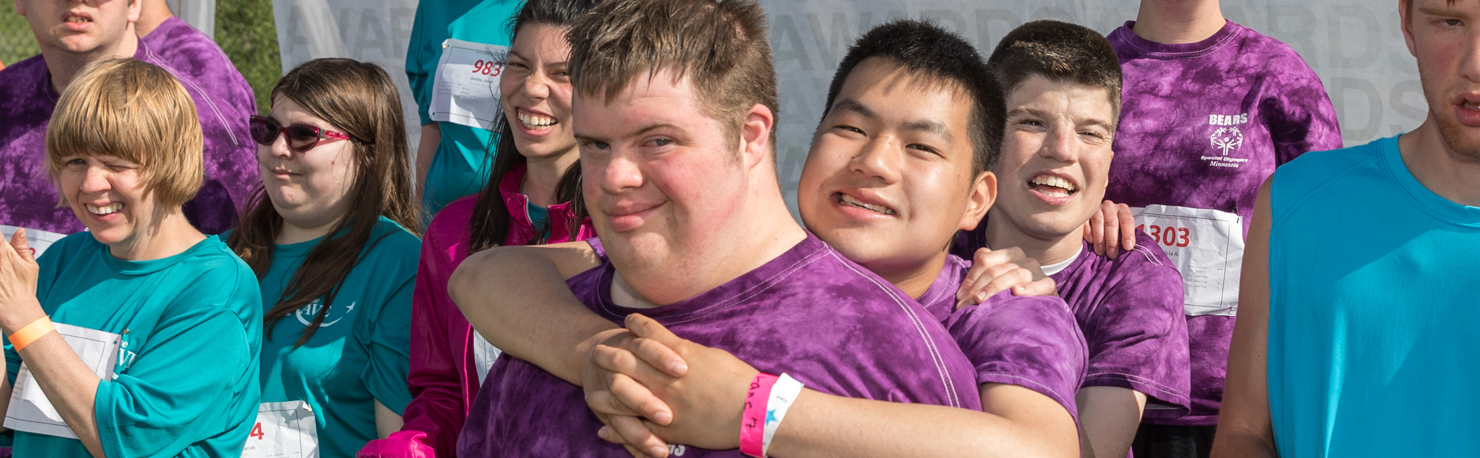 Special Olympics Minnesota athletes smile at the camera