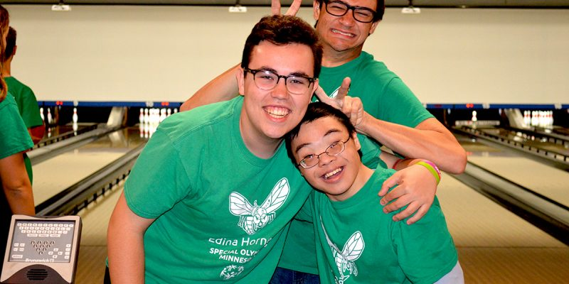 Three Unified athletes pose for a picture at the bowling alley.
