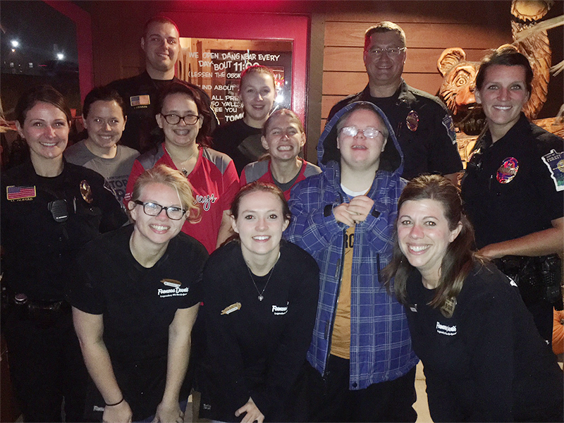 Two Special Olympics Minnesota athletes pose with law enforcement officers from Forest Lake