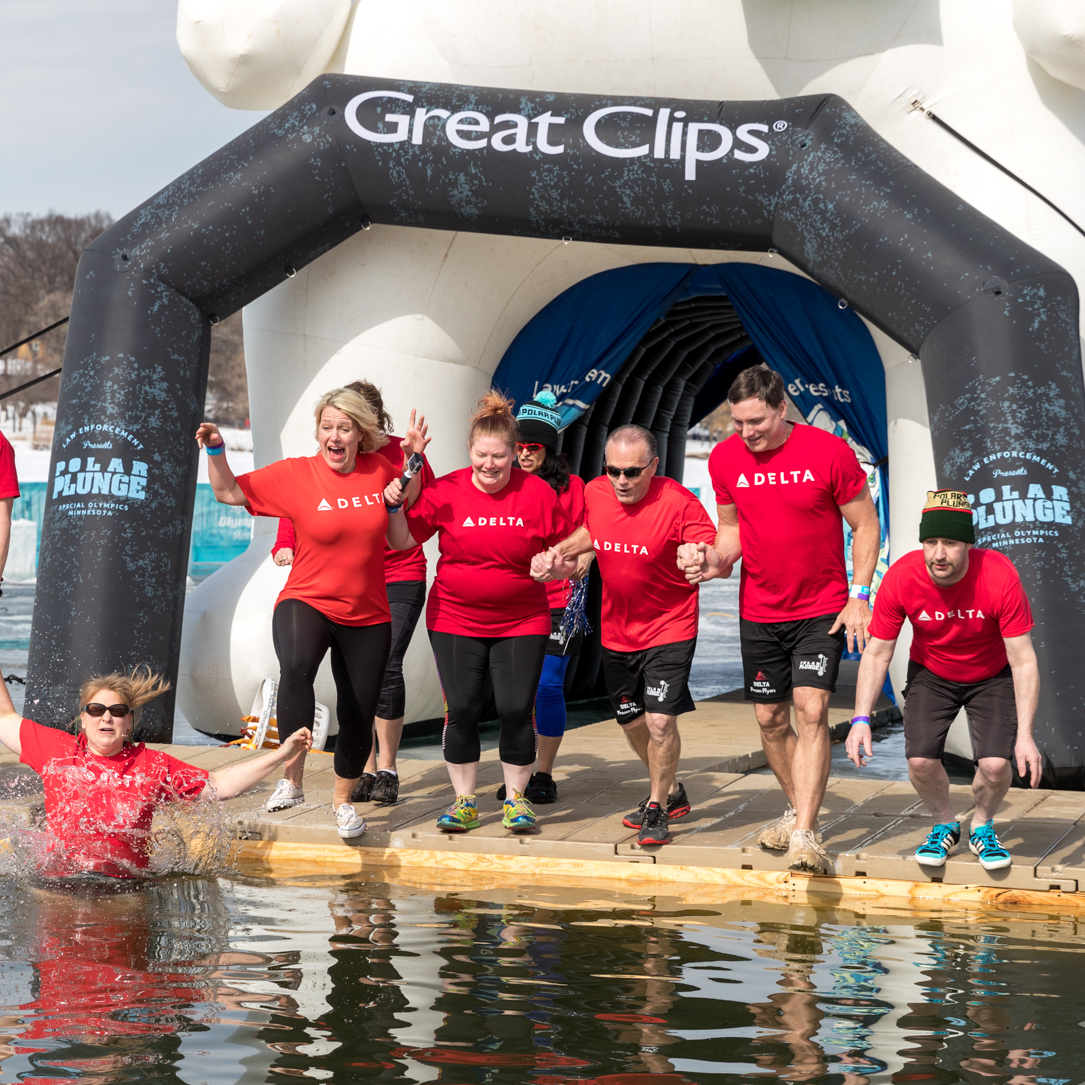 A group of Delta Air Lines take the Polar Plunge into Lake Bde Maka Ska in Minneapolis