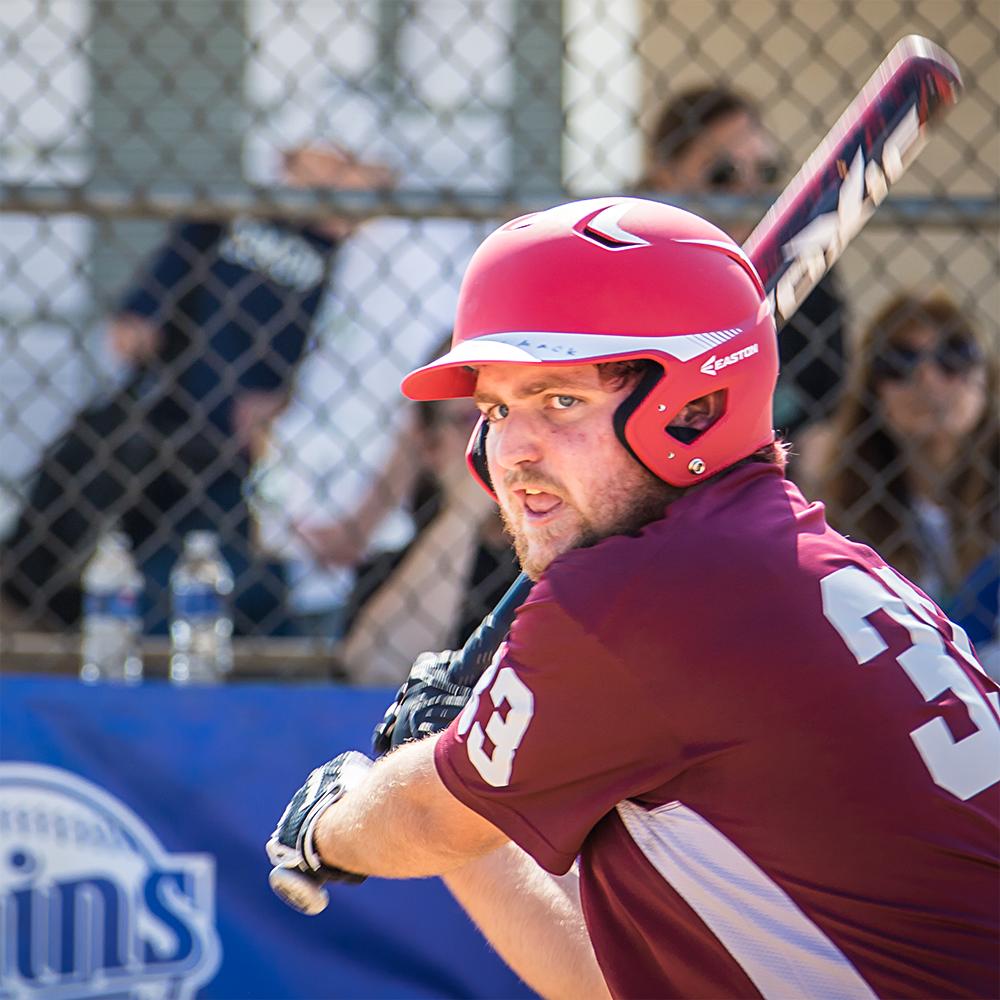 A Special Olympics Minnesota softball athlete swings his bat