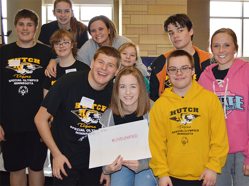 A group of Special Olympics Minnesota Youth Summit attendees] smile for the camera