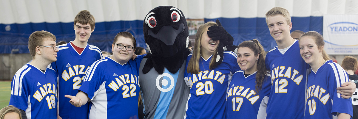 Special Olympics Minnesota soccer athletes and Unified Partners pose with Minnesota United FC's mascot, PK