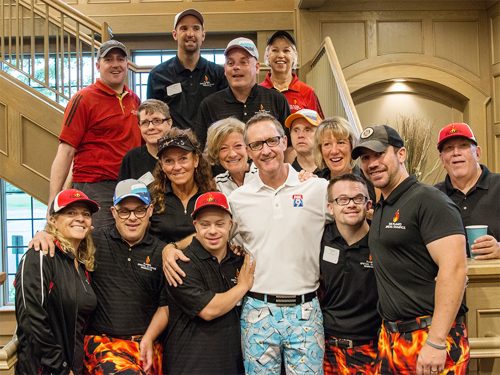 FOX 9 Chief Meteorologist Ian Leonard poses with Special Olympics Minnesota's Ian Leonard's Bad Pants Open golf athletes and other golfers